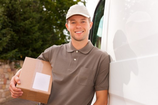 "<a href=""http://www.shutterstock.com/pic-89594563/stock-photo-postal-service-delivery-of-a-package-through-a-delivery-service-the-postman-is-leaning-on-his-van.html"">Shutterstock / Kzenon</a>"