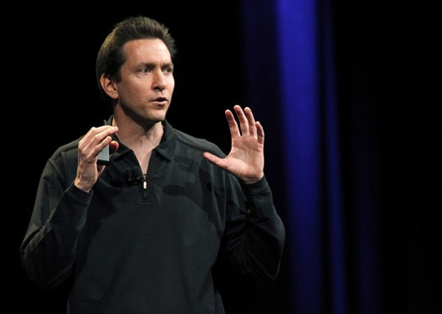 Scott Forstall, Senior Vice President of iOS Software at Apple Inc., talks about iOS 5 for the iPhone at the Apple Worldwide Developers Conference in San Francisco, California, in this June 6, 2011 file photograph. Apple Inc Chief Executive Tim Cook on October 29, 2012 replaced the heads of its software and retail units in the company's most sweeping executive shake-up in a decade following embarrassing problems with its new mapping program and unpopular store-related decisions. Software chief Scott Forstall, who oversaw the company's launch of the flawed mapping software and much criticized Siri voice-enabled assistant, will be leaving Apple next year and will serve as an advisor to Cook in the meantime.   REUTERS/Beck Diefenbach/Files  (UNITED STATES - Tags: BUSINESS)