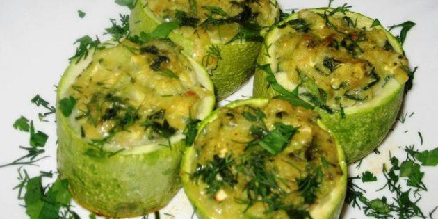 Запечённые кабачки, фаршированные зеленью и сыром