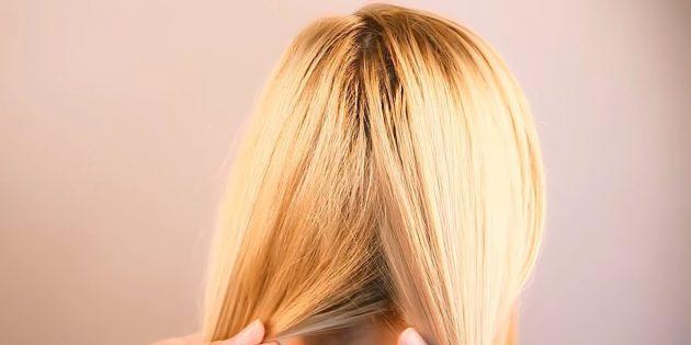Разделите волосы внизу пополам