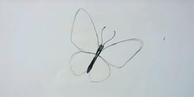 Обведите крылья и нарисуйте усики бабочки