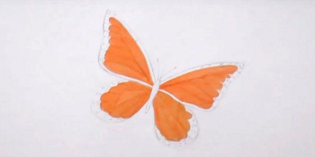 Нарисуйте кружочки по краям нижних крыльев и оранжевым фломастером выделите детали