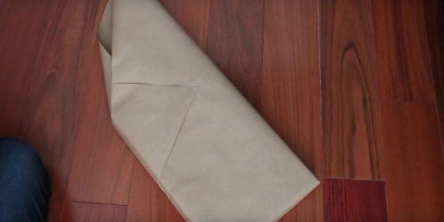 Приклейте кончик бумаги