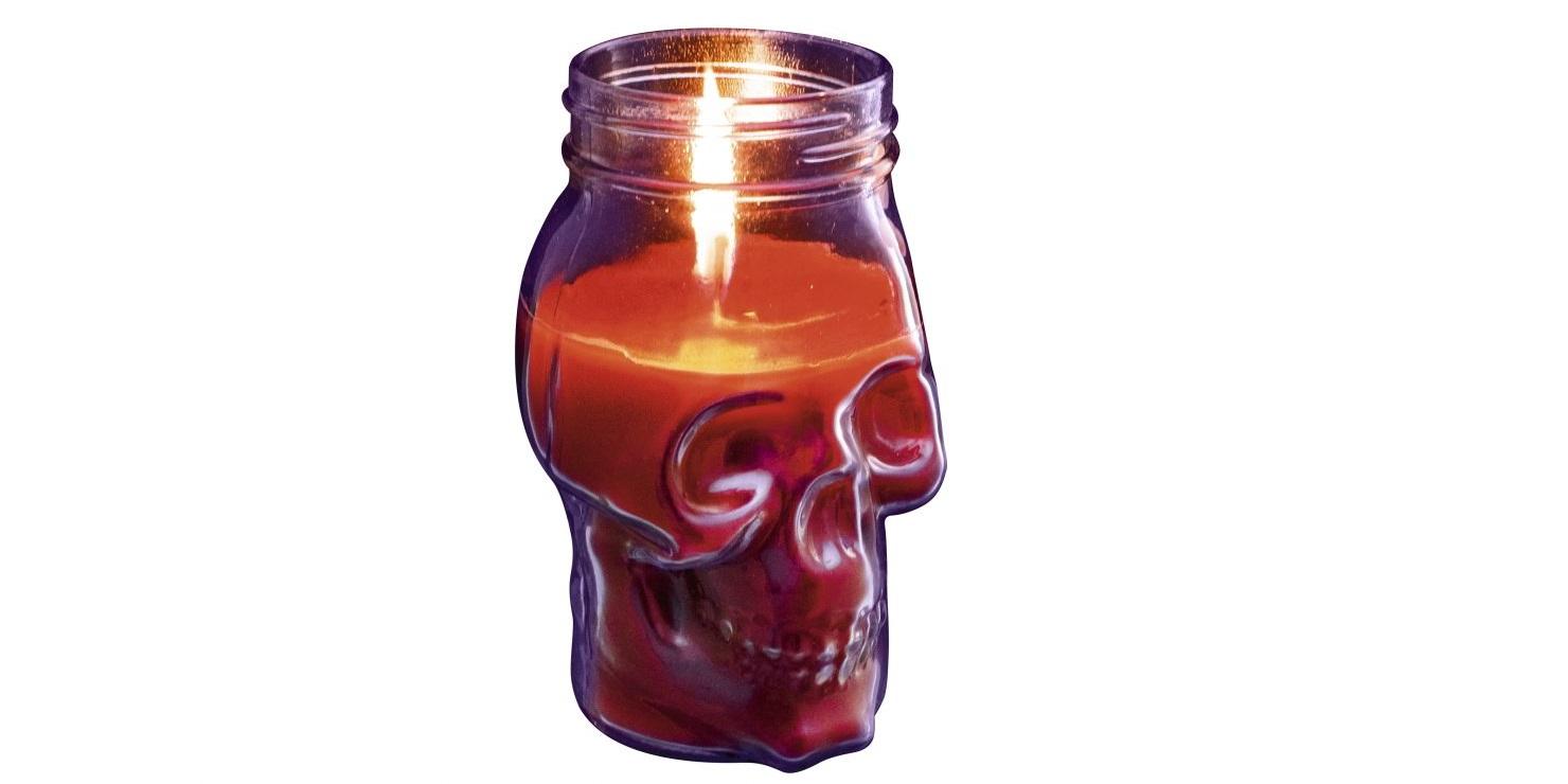 Свеча в виде черепа с подсвечником