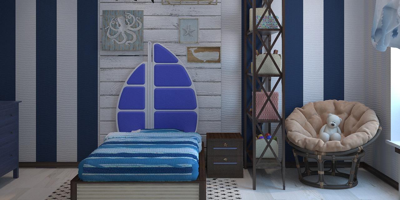 Кровать в детской отделена от кресла стеллажом
