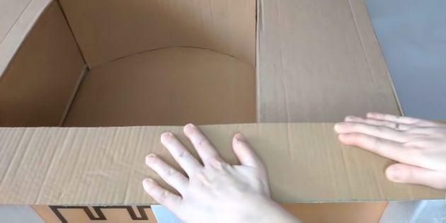 Декоративный камин своими руками: вырежьте длинную полосу из картона и оклейте ею низ камина