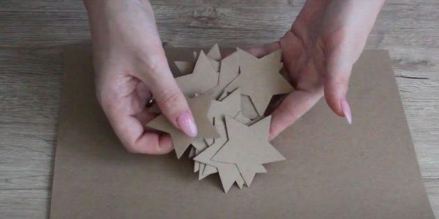 Украшение окон на Новый год: вырежьте звезды из картона