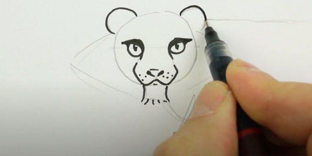 Обведите уши и морду тигра