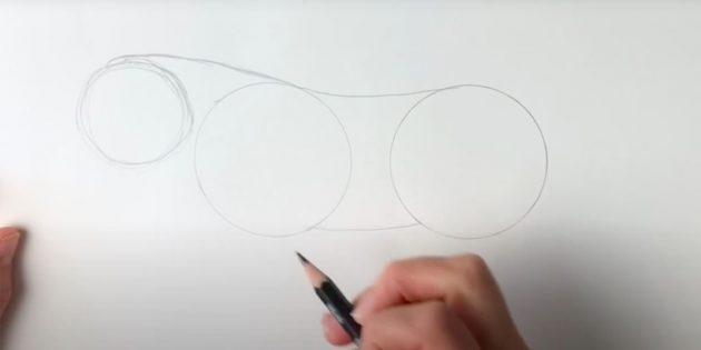 Как нарисовать тигра: Чуть выше и левее изобразите еще один круг