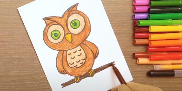 Как нарисовать сову: закрасьте глаза, лапы и ветку