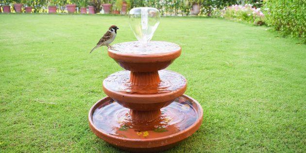 Трёхуровневый фонтан из керамических вазонов